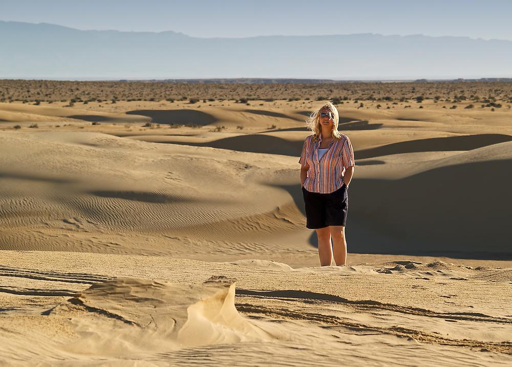 Tunisia - Woman in dunes of Sahara