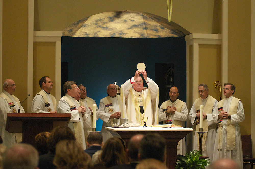 Archbishop Dolan prepares the Eucharist during the dedication ceremony of the Three Holy Companions Chapel at Marquette University High School, Wednesday Nov. 5 2008.