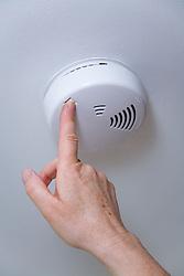 Smoke alarm being tested,