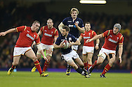 Greig Laidlaw of Scotland © looks to go past Gethin Jenkins (l) and Jonathan Davies ® of Wales. RBS Six nations championship 2016, Wales v Scotland at the Principality Stadium in Cardiff, South Wales on Saturday 13th February 2016. <br /> pic by  Andrew Orchard, Andrew Orchard sports photography.