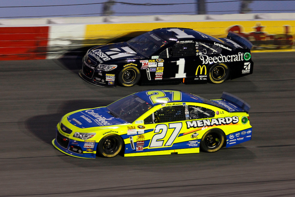 Apr 12, 2014; Darlington, SC, USA; NASCAR Sprint Cup driver Paul Menard (27) passes NASCAR Sprint Cup driver Jamie McMurray (1) during the Southern 500 at Darlington Raceway. Mandatory Credit: Peter Casey-USA TODAY Sports