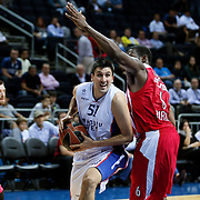 Anadolu Efes's Milko Bjelica (C) and Olympiacos's Bryant Dunston (R) during their Gloria Cup Basketball Tournament match Anadolu Efes between Olympiacos at Ulker Sports Arena in istanbul Turkey on Tuesday 23 September 2014. Photo by Aykut AKICI/TURKPIX