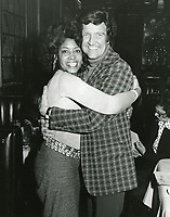 1978 Radio Commentator, Gregg Hunter hugs Abbey Lincoln at the Hollywood Brown Derby restaurant on Vine St.