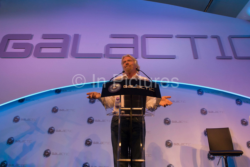 Sir Richard Branson speaks to audience during a Virgin Galactic space tourism presentation at Farnborough Air Show. Virgin Galactic is a company within Richard Branson's Virgin Group which plans to provide sub-orbital spaceflights to space tourists, suborbital launches for space science missions and orbital launches of small satellites.Sir Richard Charles Nicholas Branson (b1950) is an English business magnate, best known for his Virgin Group of more than 400 companies. Branson is the 4th richest citizen of the United Kingdom, according to the Forbes 2011 list of billionaires, with an estimated net worth of US$4.2 billion.