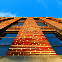 """""""Climbing the Walls""""<br /> <br /> Walls and windows against the blue sky at Eastern Michigan University!!<br /> <br /> Architecture: Structures and buildings by Rachel Cohen"""