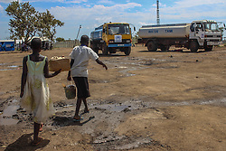Resources are scare at BidiBidi settlement More than 300,000 South Sudanese refugees have fled from the country's civil war into Uganda since fighting broke out in July. They mostly travel by foot for days through the bush as roads have been blocked or are too dangerous to cross. The massive influx of refugees has caused a strain in humanitarian aid due to large numbers and lack of funding. BidiBidi settlement is now the third largest in the world and holds more than 210,000 people since its opening in September.