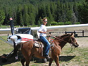 Kay Pratt preparing for a trail ride in Sulphur Creek, ID