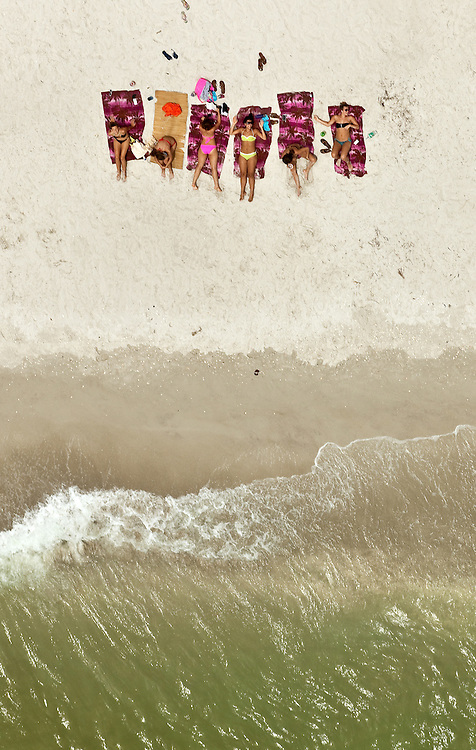David Albers/Staff<br /> - Beach-goers take in the sunshine on Naples Beach on Monday, July 23, 2012, in Naples.