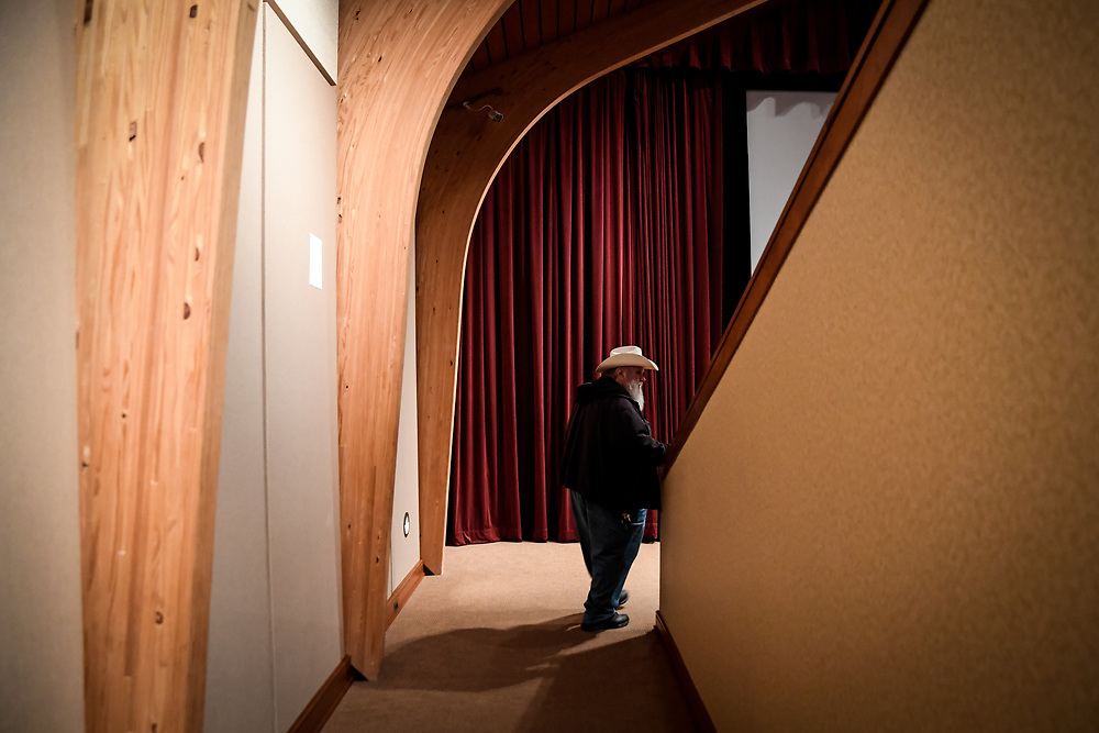 Duke enters the theatre at the Woodstock museum.