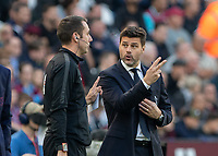 Football - 2018 / 2019 Premier League - West Ham United vs. Tottenham Hotspur<br /> <br /> Mauricio Pochettino, Manager of Tottenham FC, points out the number of fouls on one of his players to the fourth official at the London Stadium<br /> <br /> COLORSPORT/DANIEL BEARHAM