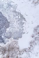 Abstract aerial view of frozen sea on Kasmu coast, Estonia.