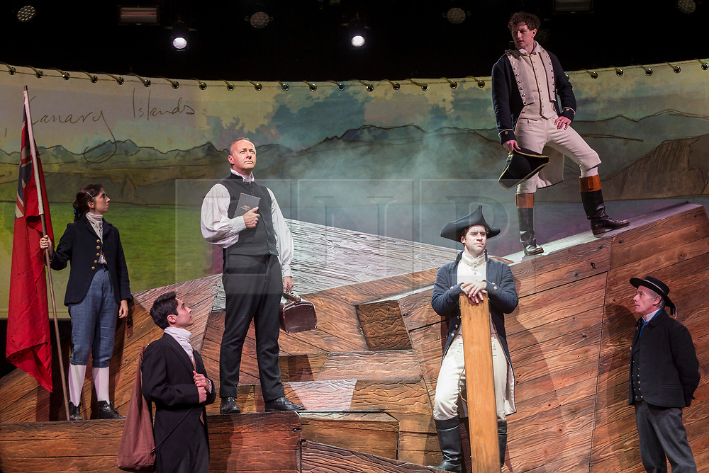 """© Licensed to London News Pictures. 10/10/2018. LONDON, UK.  Actors perform during a preview, ahead of the European premiere of """"The Wider Earth"""" at the Natural History Museum.  Actor Bradley Foster plays the young 22 year old Darwin setting out on his five year voyage on HMS Beagle.  The cast features War Horse actors, as well as 30 puppets representing the tropical wildlife Charles Darwin encountered on his voyage.  The show is hosted in the new 357-seat theatre in the Jerwood Gallery and runs until 30 December 2018.  Photo credit: Stephen Chung/LNP"""