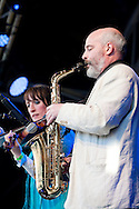 Legendary Irish traditional group Kila perform at the St Patrick's Day Festival, Trafalgar Square, London, UK. Pictured here, Colm Ó Snodaigh on saxophone and Dee Armstrong on violin. © Rudolf Abraham
