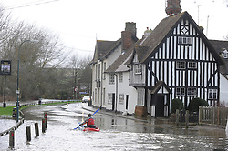 © Licensed to London News Pictures. 24/12/2013<br /> Local resident Giles Wolfe enjoying some canoeing in the road outside The Plough Pub in Eynsford,Kent. ( today 24.12.2013) <br /> Eynsford Village Flooding in Kent.<br /> The River Darent in Eynsford has flooded and closed the village ford due to heavy rain overnight.<br /> The UK  has woken up to trees and electricity cables down following a night of gale-force winds and torrential rain.<br /> Photo credit :Grant Falvey/LNP