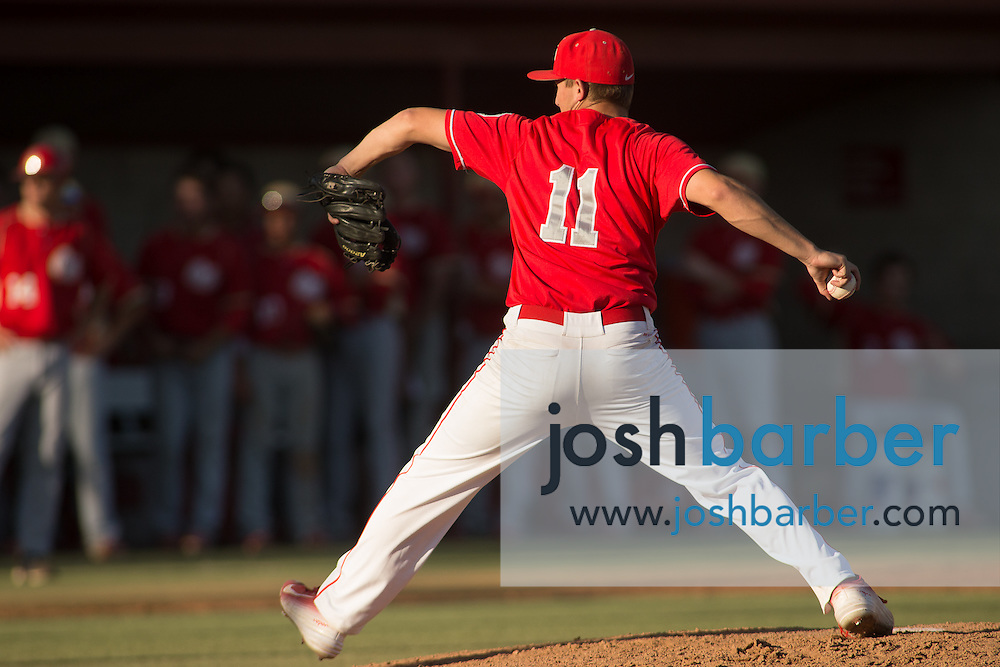 Orange Lutheran's Isaac Martinez (11) pitching during a Trinity League game at Mater Dei High School on Friday, May 1, 2015 in Santa Ana, Calif. (Photo/Josh Barber)