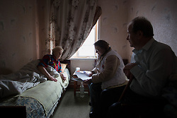 Doctor Svetlana Niekurasa (c) consults with Svetlana Vorobyeva, 74, who suffers from hypertension and has become immobile in her home in Debaltsevo. Ivan, 74, looks after his wife and has been visited three times over the past there weeks by the MSF team.