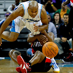January 16, 2012; New Orleans, LA, USA; New Orleans Hornets point guard Jarrett Jack (2) is grabbed by Portland Trail Blazers point guard Raymond Felton (5) as he scrambles for a loose ball during the second quarter of a game at the New Orleans Arena.   Mandatory Credit: Derick E. Hingle-US PRESSWIRE