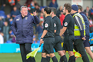 AFC Wimbledon manager Wally Downes talking to the ref during the EFL Sky Bet League 1 match between AFC Wimbledon and Doncaster Rovers at the Cherry Red Records Stadium, Kingston, England on 9 March 2019.