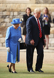 Queen Elizabeth II and US President Donald Trump walk in the Quadrangle during a ceremonial welcome at Windsor Castle, Windsor.