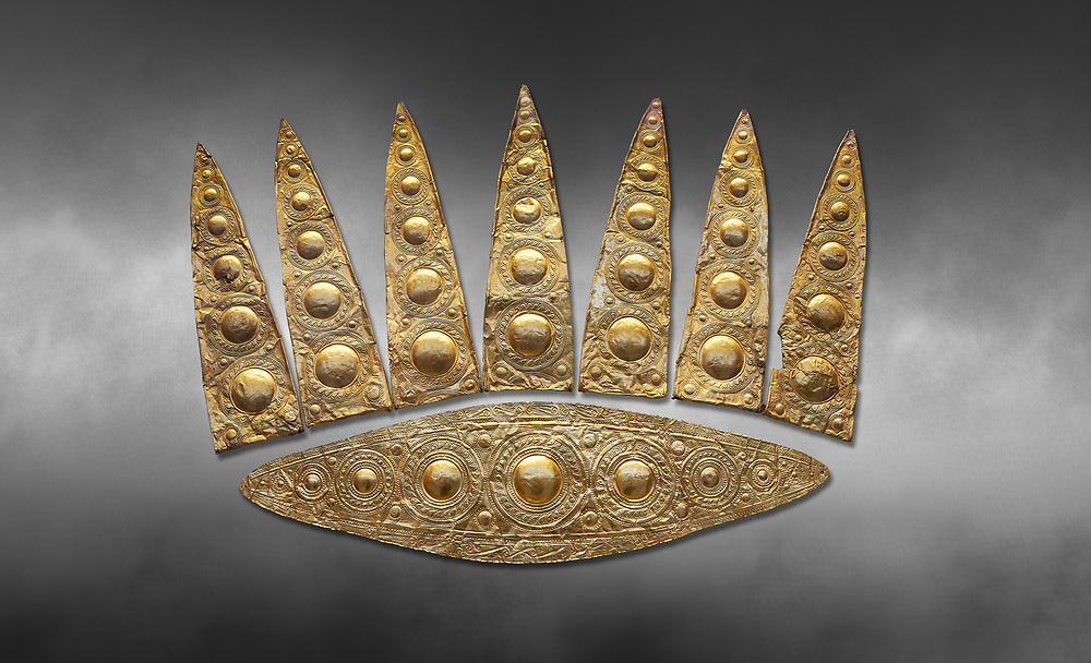 Top leaf shapes of a Mycenaean gold diadem from Grave III, 'Grave of a Women', Grave Circle A, Myenae, Greece. National Archaeological Museum Athens. Grey art Background <br /> <br /> Cat No 3,5. 16th century BC.<br /> <br /> Shaft Grave III, the so-called 'Grave of the Women,' contained three female and two infant interments. The women were literally covered in gold jewelry and wore massive gold diadems, while the infants were overlaid with gold foil. .<br /> <br /> If you prefer to buy from our ALAMY PHOTO LIBRARY  Collection visit : https://www.alamy.com/portfolio/paul-williams-funkystock/mycenaean-art-artefacts.html . Type -   Athens    - into the LOWER SEARCH WITHIN GALLERY box. Refine search by adding background colour, place, museum etc<br /> <br /> Visit our MYCENAEN ART PHOTO COLLECTIONS for more photos to download  as wall art prints https://funkystock.photoshelter.com/gallery-collection/Pictures-Images-of-Ancient-Mycenaean-Art-Artefacts-Archaeology-Sites/C0000xRC5WLQcbhQ