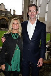 """MANDY D'ABO and TED WILSON at a private view to view """"The Coronation Theatre: Portrait of Her Majesty Queen Elizabeth II"""" painted by Ralph Heimans held at Westminster Abbey, London on 12th September 2013."""