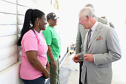 The Prince of Wales visits residents at the Holy Trinity School in Codrington, Barbuda as he continues his tour of hurricane-ravaged Caribbean islands.