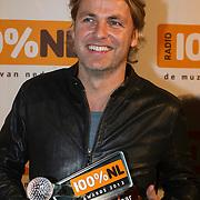 NLD/Amsterdam/20140205 - Uitreiking 100% NL Awards 2013, John Ewbank met de award voor Marco Borsato