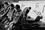 Jimaan, Badr and Alaà sometimes skip going to the mosque and instead hold their Friday prayers at the front line.<br /> Nov. 2002 The boys from Ramallah.