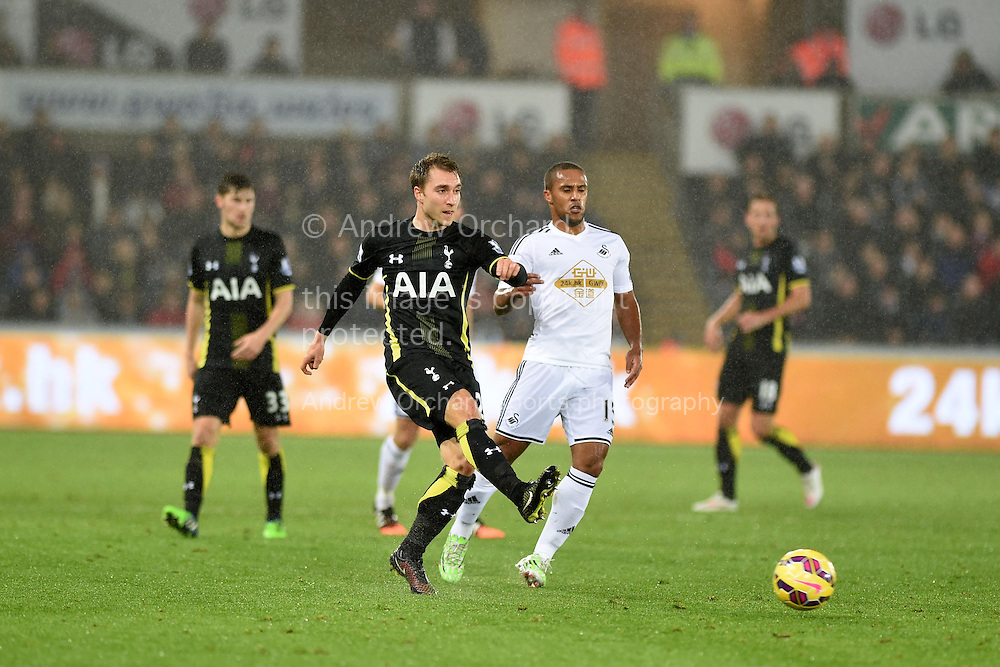 Christian Eriksen of Tottenham is closed down by Wayne Routledge of Swansea. Barclays Premier League match, Swansea city v Tottenham Hotspur at the Liberty Stadium in Swansea, South Wales on Sunday 14th December 2014<br /> pic by Andrew Orchard, Andrew Orchard sports photography.