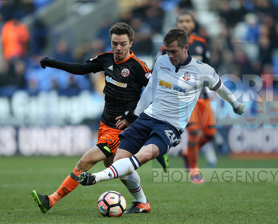 Stefan Scougall of Sheffield Utd tussles with Andrew Taylor of Bolton during the FA Cup Second round match at the Macron Stadium, Bolton. Picture date: December 4th, 2016. Pic Simon Bellis/Sportimage