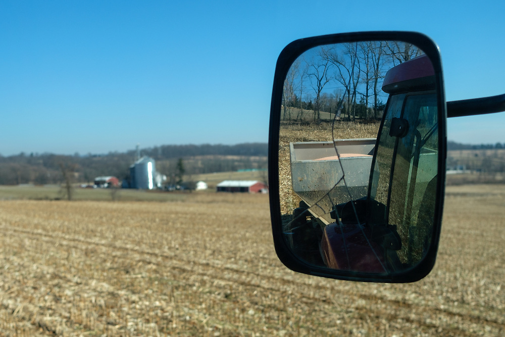 Grain farmer Scott Clucas drives a combine through a field of soybeans during harvesting on Feb. 4, 2019, in Port Clinton, New Jersey.