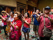 "08 FEBRUARY 2016 - BANGKOK, THAILAND:  People pray for Chinese New Year at Wat Mangon Kamlawat, the largest Mahayana (Chinese) Buddhist temple in Bangkok during the celebration of the Lunar New Year. Chinese New Year is also called Lunar New Year or Tet (in Vietnamese communities). This year is the ""Year of the Monkey."" Thailand has the largest overseas Chinese population in the world; about 14 percent of Thais are of Chinese ancestry and some Chinese holidays, especially Chinese New Year, are widely celebrated in Thailand.      PHOTO BY JACK KURTZ"