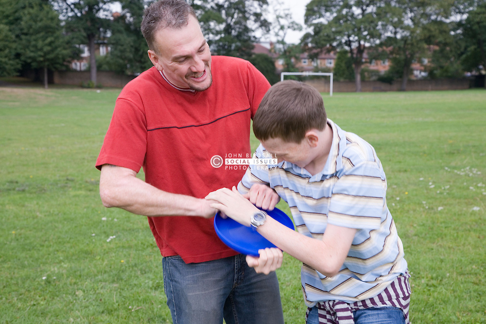 Father and son playing with a Frisbee,