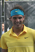 Raphael Nadal at the Nike Youth Tennis  Challenge held at The Nike -Built regulation Tennis Court  on West 23rd Street & Broadway in New York  City . ..Hundreds of tennis fans and youth form New York  Parks and Rec. Athlethes for Charity, and Mentoring USA are treating to tips and guidance from Tennis Pros Roger Federer, Rafael Nadal and Serena Williams...