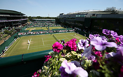 A general view of court 14 on day two of the Wimbledon Championships at the All England Lawn Tennis and Croquet Club, Wimbledon. PRESS ASSOCIATION Photo. Picture date: Tuesday July 3, 2018. See PA story TENNIS Wimbledon. Photo credit should read: Steven Paston/PA Wire. RESTRICTIONS: Editorial use only. No commercial use without prior written consent of the AELTC. Still image use only - no moving images to emulate broadcast. No superimposing or removal of sponsor/ad logos. Call +44 (0)1158 447447 for further information.
