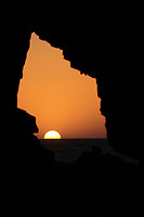 sunset inside the pedra furada bored rock beach main attraction in the beautiful fisherman village of Jericoacoara in ceara state brazil
