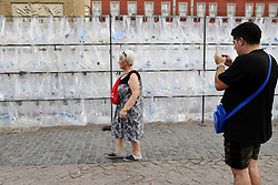 June 16, 2017 - Madrid, Spain - Anonymous artist ''Colective Luzinterruptus'' create the artistic piece ''The waste Maze'', an installation open to the public from 15 to 18 june. The installation are built from used plastic bags and bottles. The empty bottles mainly be collected from in and around Plaza Mayor, Main Square. (Credit Image: © M.Ramirez/Pacific Press via ZUMA Wire)