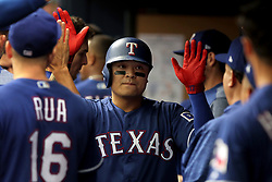April 18, 2018 - St. Petersburg, FL, U.S. - ST. PETERSBURG, FL - APR 18: Shin-Soo Choo (17) of the Rangers is congratulated by his teammates after his home run during the MLB regular season game between the Texas Rangers and the Tampa Bay Rays on April 18, 2018, at Tropicana Field in St. Petersburg, FL. (Photo by Cliff Welch/Icon Sportswire) (Credit Image: © Cliff Welch/Icon SMI via ZUMA Press)