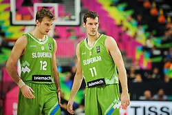 Zoran Dragic of Slovenia and brother Goran Dragic of Slovenia during basketball match between National Teams of Slovenia and Dominican Republic in Eight-finals of FIBA Basketball World Cup Spain 2014, on September 6, 2014 in Palau Sant Jordi, Barcelona, Spain. Photo by Tom Luksys  / Sportida.com <br /> ONLY FOR Slovenia, France