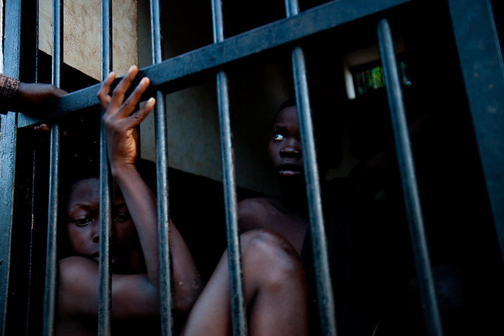 Two boys locked up for stealing provesions from the NGO World Vision in Tumbura. The countries justice system is still in it's infancy.