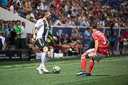July 28, 2018 - Harrison, New Jersey, United States - Juventus forward FEDERICO BERNARDESCHI (33) dribbles the ball past SL Benfica defender ÁLEX GRIMALDO (3) during the International Champions Cup at Red Bull Arena in Harrison, NJ.  Juventes vs Benfica (Credit Image: © Mark Smith via ZUMA Wire)