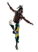 one Brazilian black man soccer player kicking football on white background