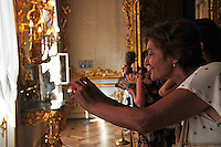 Visitors are ushered through a series of ornate rooms at the Catherine Palace at Tsarskoe Selo (Pushkin) near St. Petersburg, Russia.