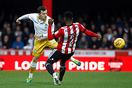 Ross Wallace of Sheffield Wednesday (L) battles with Florian Jozefzoon of Brentford (R). EFL Skybet football league championship match, Brentford v Sheffield Wednesday at Griffin Park in London on Saturday 30th December 2017.<br /> pic by Steffan Bowen, Andrew Orchard sports photography.