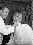 Mr Noel Purcell having his beard removed for Pantomime - Special for Radio Review.<br /> <br /> 23/12/1955
