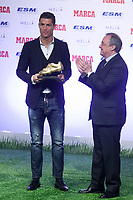 Real Madrid´s Cristiano Ronaldo (L) receives from Florentino Perez the Golden Boot `Bota de Oro´ 2013-14 to the best striker, at Melia Hotel in Madrid, Spain. November 05, 2014. (ALTERPHOTOS/Victor Blanco)