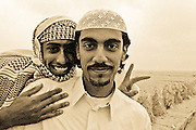Two Qatari Friends in the Al Zubara fort on the Northwest coast of Qatar. Built in 1938 during the reign of Skeikh Abdullah Bin Qassim Al Thani. Now a museum and tourist attraction. Qatar, Middle East
