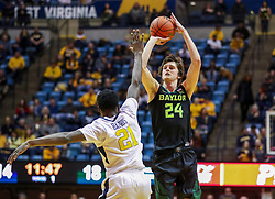 Jan 21, 2019; Morgantown, WV, USA; Baylor Bears guard Matthew Mayer (24) shoots over West Virginia Mountaineers forward Wesley Harris (21) during the first half at WVU Coliseum. Mandatory Credit: Ben Queen-USA TODAY Sports