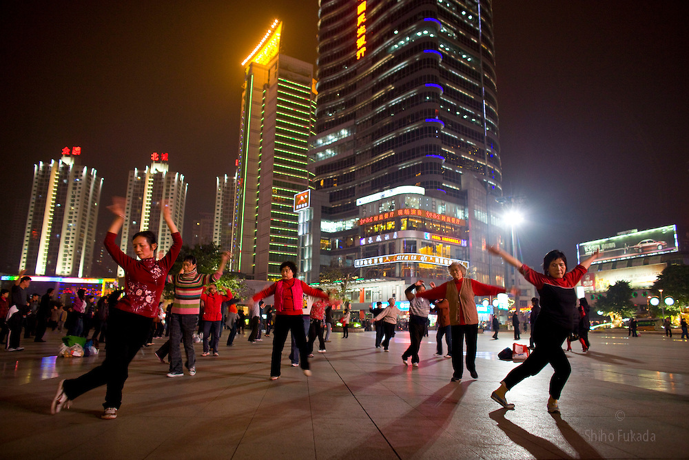 People enjoy night life in Chongqing, China, March 4, 2009.