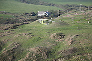 Grass covered Eco home contrasts with traditional building,near Nolton, Pembrokeshire national park, Wales